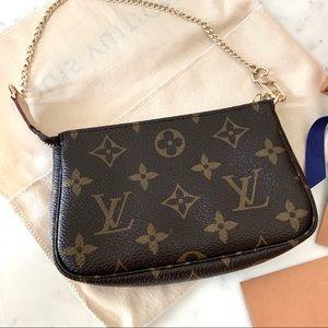 ✨Brand new. Never worn. Louis Vuitton mini pouch